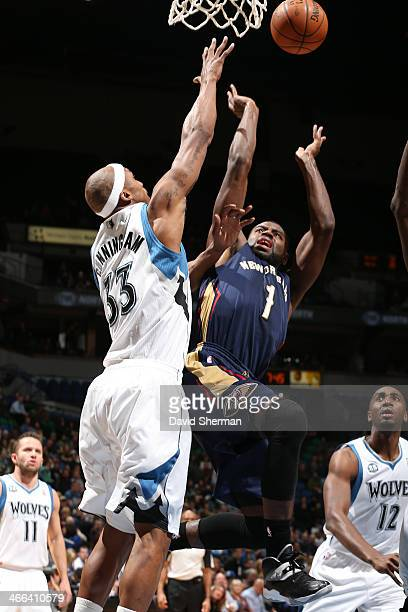Tyreke Evans of the New Orleans Pelicans shoots against Dante Cunningham of the Minnesota Timberwolves on January 29 2014 at Target Center in...