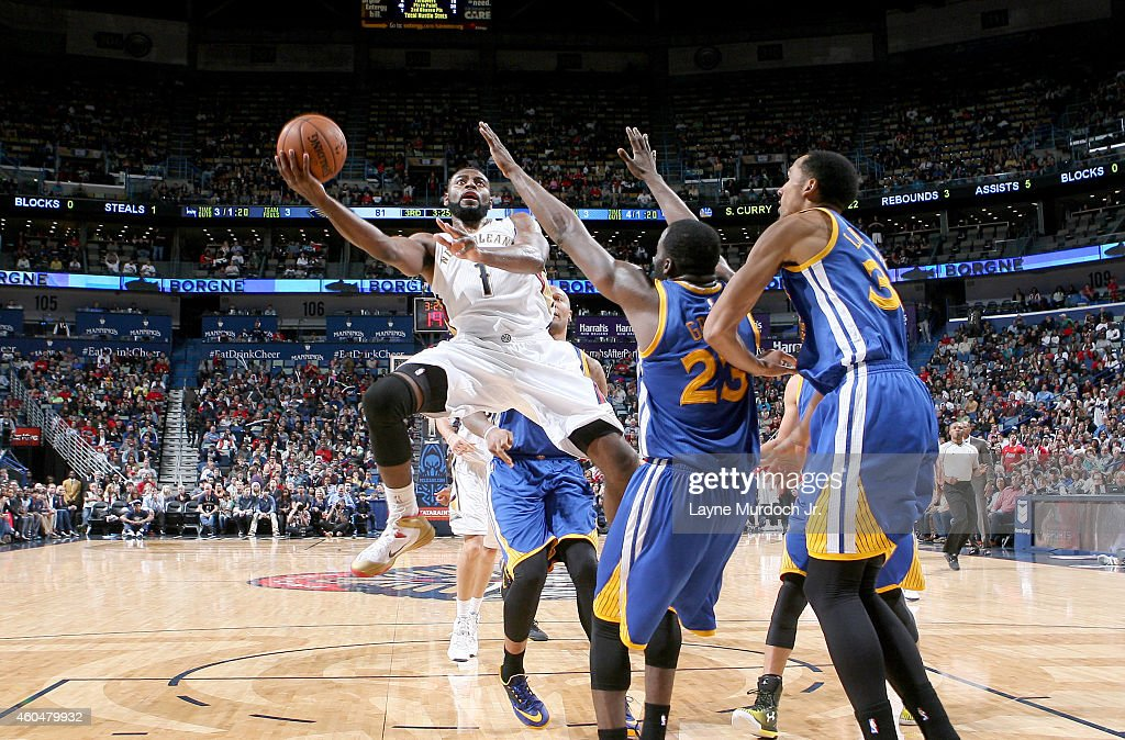 Tyreke Evans #1 of the New Orleans Pelicans shoots against the Golden State Warriors during an NBA game on December 14, 2014 at the Smoothie King Center in New Orleans, Louisiana.