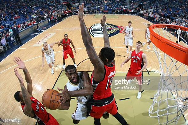 Tyreke Evans of the New Orleans Pelicans shoots against the Toronto Raptors on March 19 2014 at the Smoothie King Center in New Orleans Louisiana...