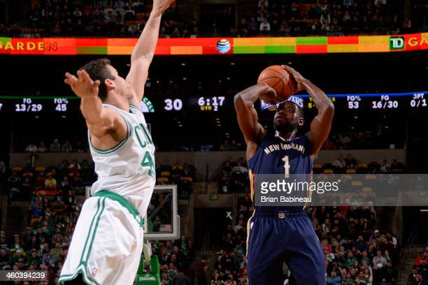 Tyreke Evans of the New Orleans Pelicans shoots the ball against Kris Humphries of the Boston Celtics on January 3, 2014 at the TD Garden in Boston,...