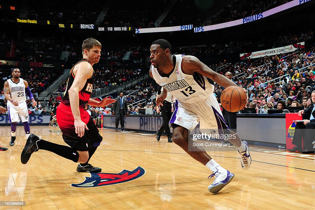 Tyreke Evans #13 of the Sacramento Kings drives to the basket against Kyle Korver #26 of the Atlanta Hawks on February 22, 2013 at Philips Arena in Atlanta, Georgia.