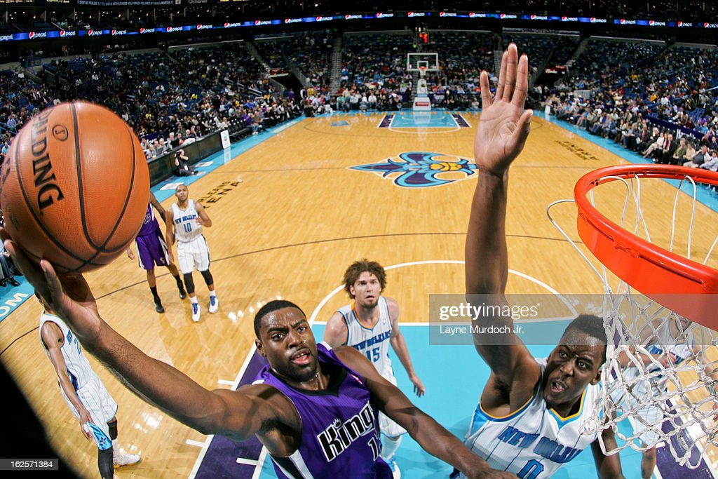 Tyreke Evans #13 of the Sacramento Kings drives to the basket against Al-Farouq Aminu #0 of the New Orleans Hornets on February 24, 2013 at the New Orleans Arena in New Orleans, Louisiana.
