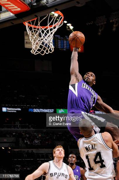 Tyreke Evans of the Sacramento Kings dunks over Gary Neal of the San Antonio Spurs on April 6 2011 at ATT Center in San Antonio Texas NOTE TO USER...