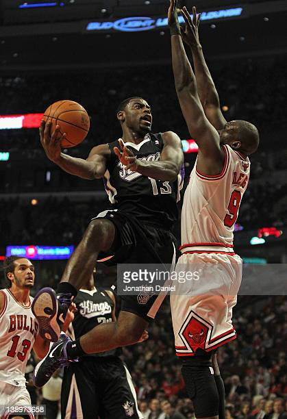 Tyreke Evans of the Sacramento Kings goes up for a shot against Loul Deng of the Chicago Bulls at the United Center on February 14 2012 in Chicago...