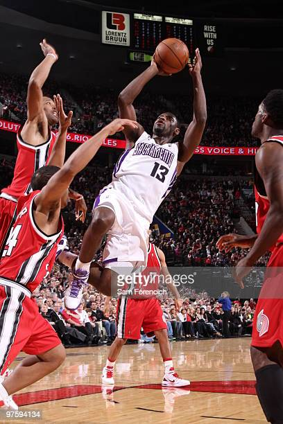 Tyreke Evans of the Sacramento Kings goes up for a shot over Andre Miller of the Portland Trail Blazers during a game on March 9 2010 at the Rose...