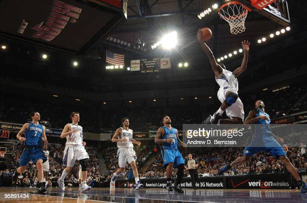 Tyreke Evans of the Sacramento Kings lays up a shot against Rashard Lewis of the Orlando Magic during the game on January 12 2010 at Arco Arena in...