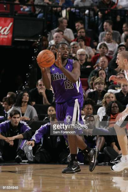 Tyreke Evans of the Sacramento Kings looks to pass around Steve Blake of the Portland Trail Blazers during a game on October 6 2009 at the Rose...