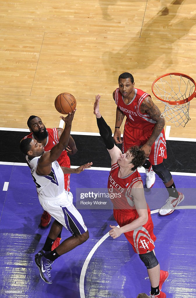 Tyreke Evans #13 of the Sacramento Kings shoots against Omer Asik #3 of the Houston Rockets on April 3, 2013 at Sleep Train Arena in Sacramento, California.