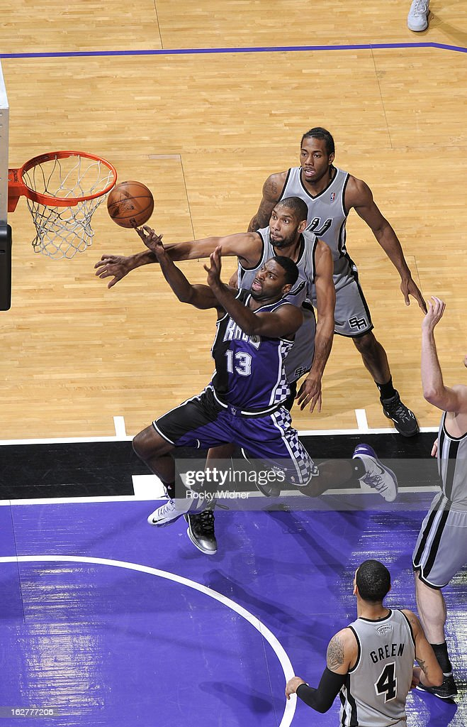 Tyreke Evans #13 of the Sacramento Kings shoots against Tim Duncan #21 of the San Antonio Spurs on February 19, 2013 at Sleep Train Arena in Sacramento, California.