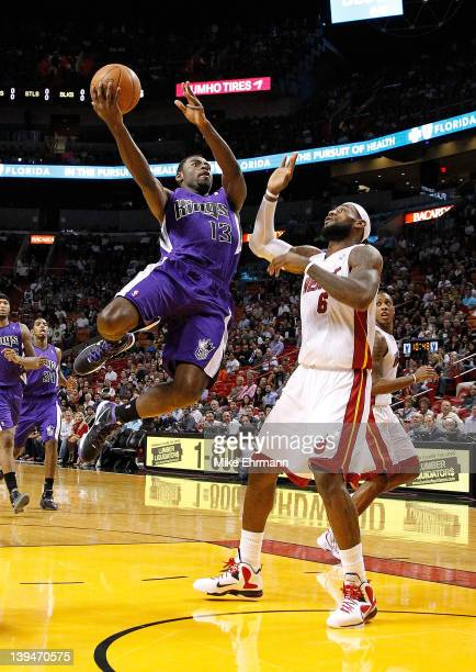 Tyreke Evans of the Sacramento Kings shoots over LeBron James of the Miami Heat during a game at American Airlines Arena on February 21 2012 in Miami...