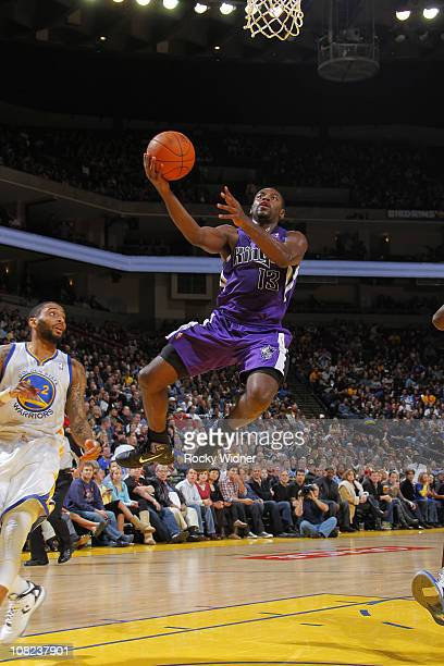 Tyreke Evans of the Sacramento Kings soars through the air for a layup against Acie Law of the Golden State Warriors on January 21 2011 at Oracle...