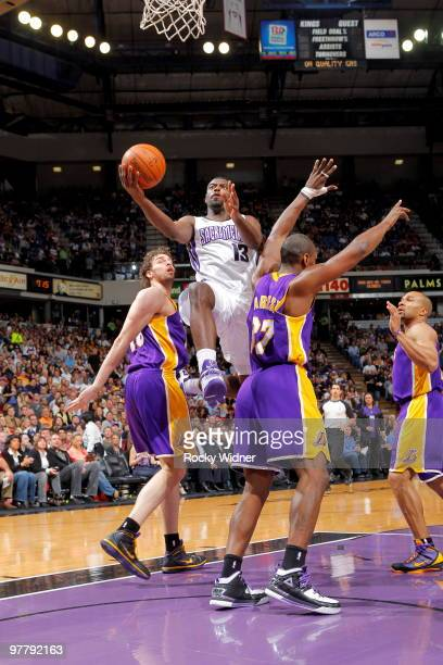 Tyreke Evans of the Sacramento Kings takes the ball to the basket against Ron Artest of the Los Angeles Lakers on March 16 2010 at ARCO Arena in...