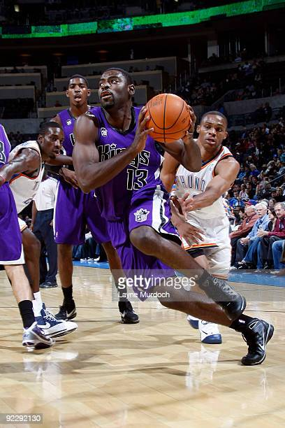 Tyreke Evans of the Sacremento Kings dribbles past Russell Westbrook of the Oklahoma City Thunder on October 22 2009 at the Ford Center in Oklahoma...