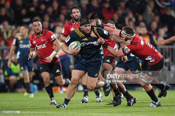Tyrel Lomax of the Highlanders is tackled by Kieran Read of the Crusaders during the round 9 Super Rugby match between the Crusaders and Highlanders...