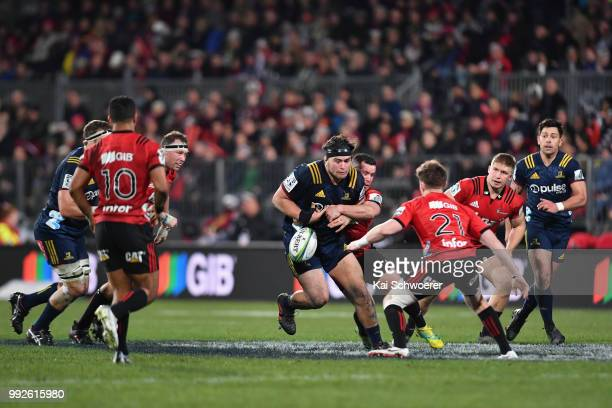 Tyrel Lomax of the Highlanders is tackled by Ryan Crotty of the Crusaders during the round 18 Super Rugby match between the Crusaders and the...