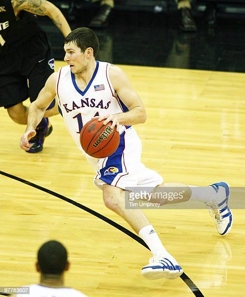 Tyrel Reed of the Kansas Jayhawks drives the lane against the Kansas State Wildcats in the 2010 Phillips 66 Big 12 Men's Basketball Championship on...