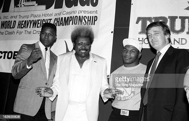Tyrell Biggs Promoter Don King Mike Tyson and Donald Trump pose during the press conference to promote the fight between Mike Tyson and Tyrell Biggs...