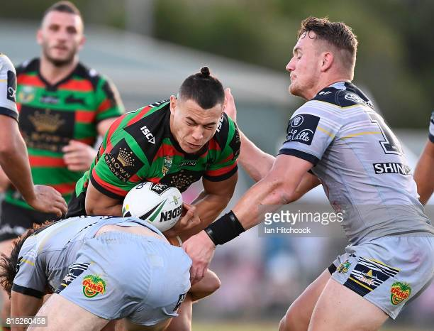 Tyrell Fuimaono of the Rabbitohs is tackled by Coen Hess of the Cowboys during the round 19 NRL match between the South Sydney Rabbitohs and the...