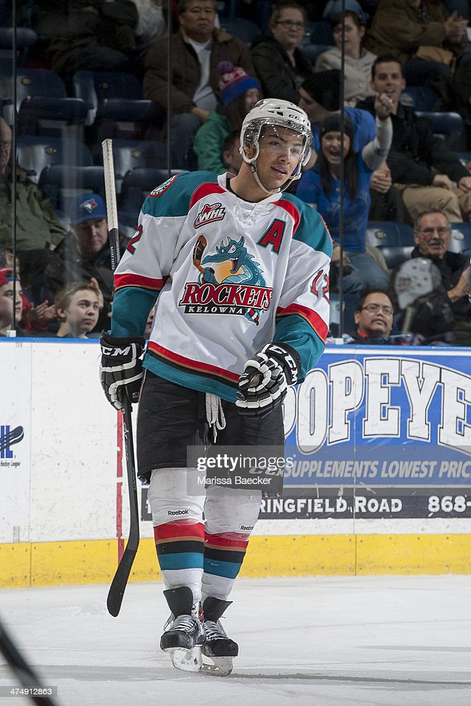 Tyrell Goulbourne #12 of the Kelowna Rockets skates to the bench after scoring a hat trick during third period against the Prince George Cougars on February 25, 2014 at Prospera Place in Kelowna, British Columbia, Canada.