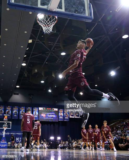 Tyrell Harrison of Brisbane dunks the ball at warmup during the round six NBL match between the Brisbane Bullets and the Cairns Taipans at Brisbane...