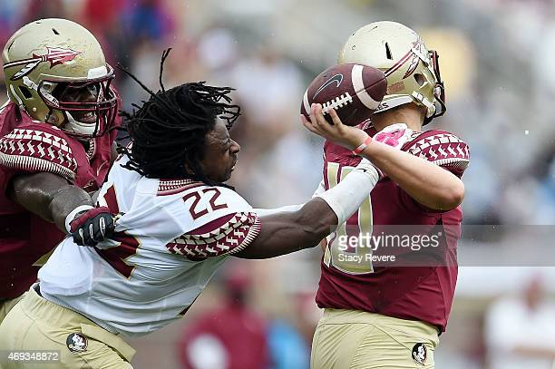 Tyrell Lyons of the Gold team pressures Sean Maguire of the Garnet team during Florida State's Garnet and Gold spring game at Doak Campbell Stadium...