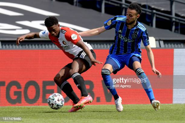 Tyrell Malacia of Feyenoord, Noussair Mazraoui of Ajax during the Dutch Eredivisie match between Feyenoord and Ajax at de Kuip on May 9, 2021 in...