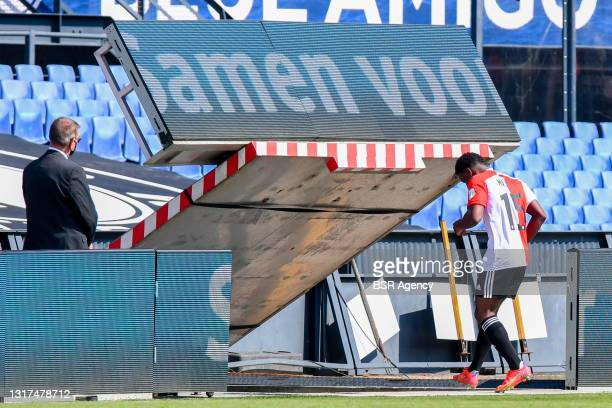 Tyrell Malacia of Feyenoord Rotterdam walks off after being given a red card during the Dutch Eredivisie match between Feyenoord Rotterdam and Ajax...