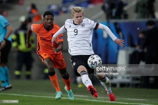 Tyrell Malacia of Holland U21, Jonathan Burkardt of Germany U21 during the EURO U21 match between Holland v Germany at the Mol Arena Sosto on June 3,...