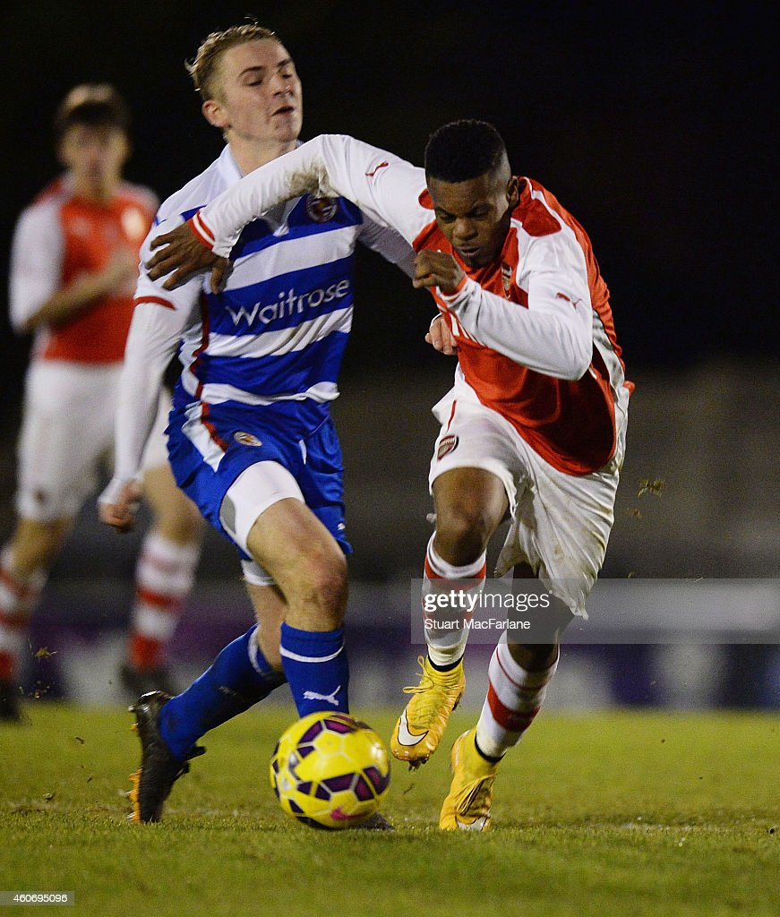 Tyrell Robinson of Arsenal breaks past Jake Sheppard of Reading during the FA Youth Cup 3rd Round match between Arsenal and Reading at Meadow Park on December 19, 2014 in Borehamwood, England.