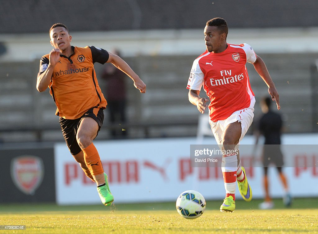 Tyrell Robinson of Arsenal takes on Aaron Simpson of Wolves during the match between Arsenal U21s and Wolverhampton Wanderers U21s at Meadow Park on May 18, 2015 in Borehamwood, England.