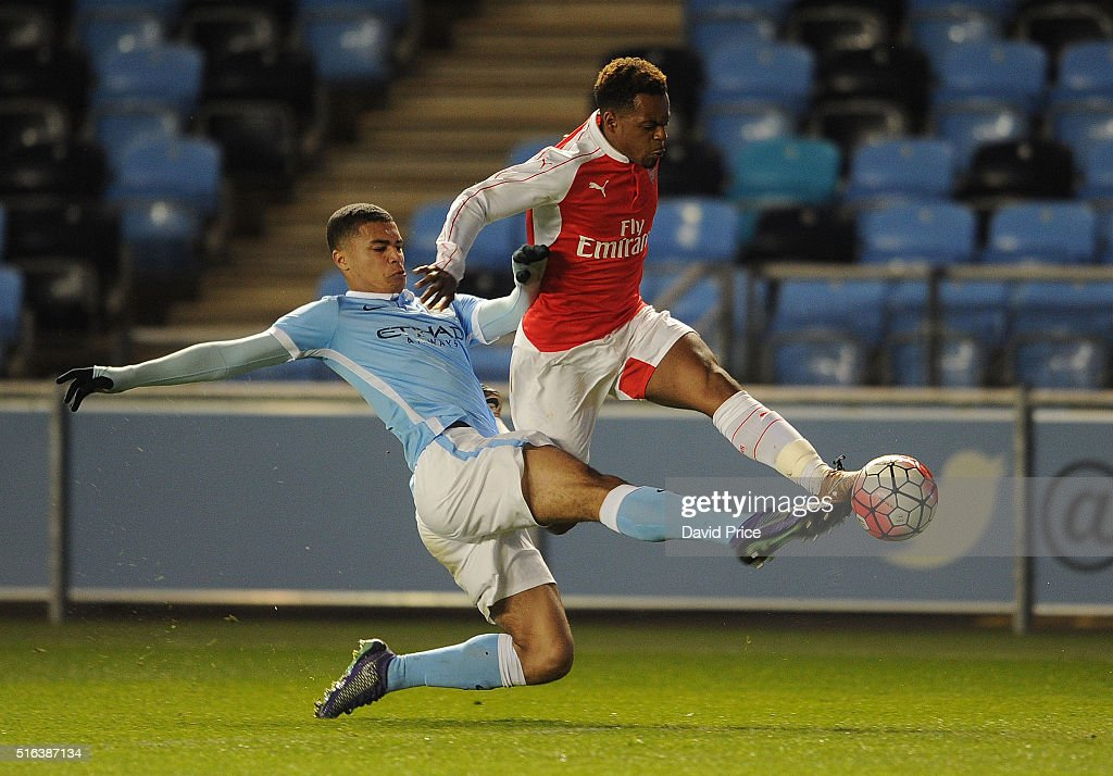 Tyrell Robinson of Arsenal takes on Cameron Humphreys-Grant of Man City during the match between Manchester City and Arsenal in the FA Youth Cup semi final 1st leg on March 18, 2016 in Manchester, England.