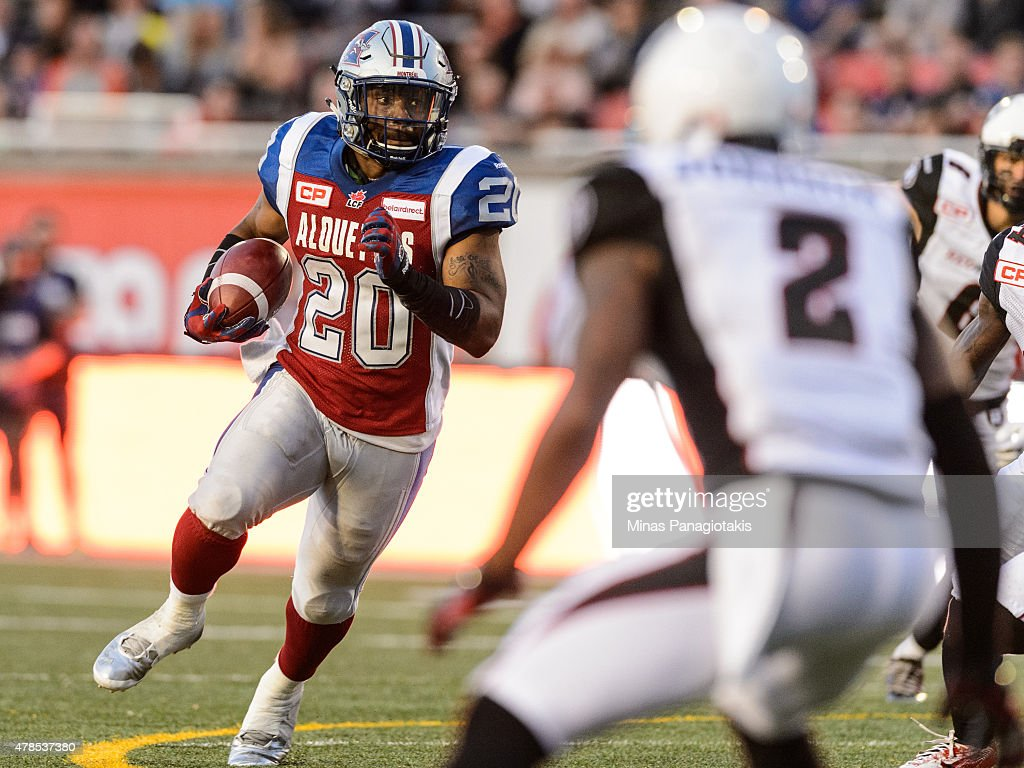 Tyrell Sutton #20 of the Montreal Alouettes runs with the ball during the CFL game against the Ottawa Redblacks at Percival Molson Stadium on June 25, 2015 in Montreal, Quebec, Canada.