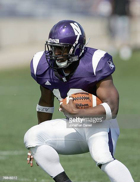 Tyrell Sutton of the Northwestern Wildcats carries the ball during the game against the Nevada Wolf Pack on September 8, 2007 at Ryan Field at...