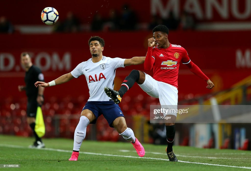 Tyrell Warren of Manchester United controls Keanan Bennetts of Tottenham Hotspur during the Premier League 2 match between Manchester United and Tottenham Hotspur at Old Trafford on January 29, 2018 in Manchester, England.