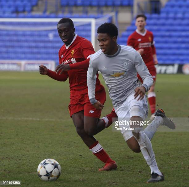Tyrell Warren of Manchester United U19s in action with Bobby Adekanye of Liverpool U19s during the UEFA Youth League match between Manchester United...