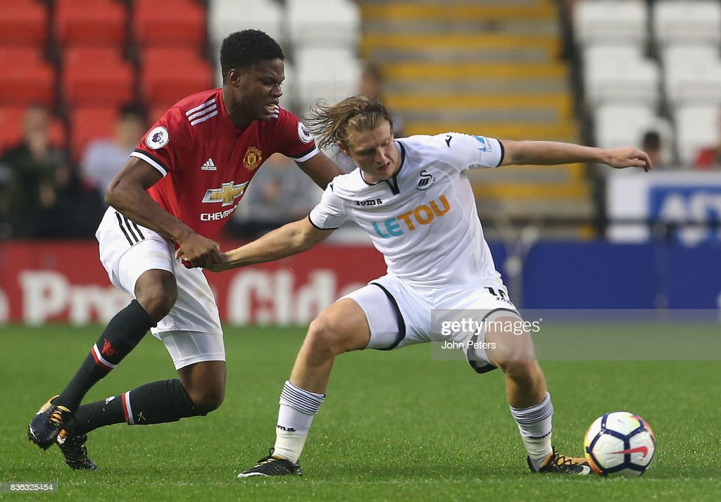 Tyrell Warren of Manchester United U23s in action with George Byers of Swansea City during the Premier League 2 match between Manchester United U23s and Swansea City U23s at Leigh Sports Village on August 21, 2017 in Leigh, Greater Manchester.