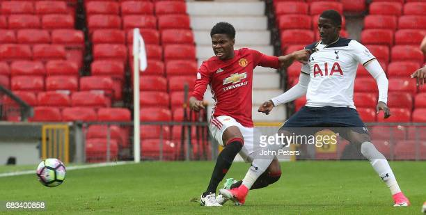 Tyrell Warren of Manchester United U23s in action with Shilow Tracey of Tottenham Hotspur U23s during the Premier League 2 match between Manchester...