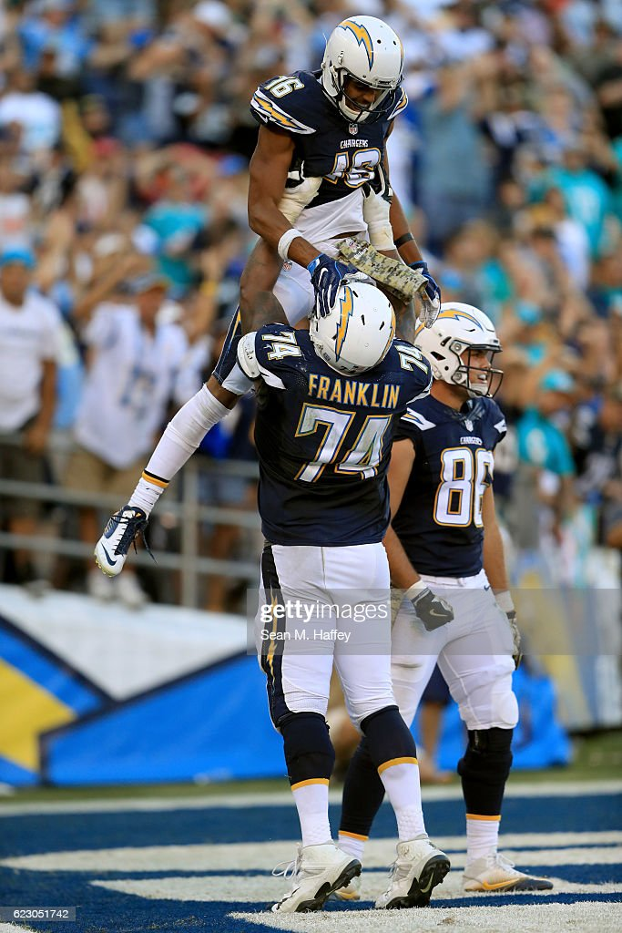 Tyrell Williams #16 and Orlando Franklin #74 of the San Diego Chargers react in the end zone after Williams' touchdown against the Miami Dolphins during the second half of a game at Qualcomm Stadium on November 13, 2016 in San Diego, California.