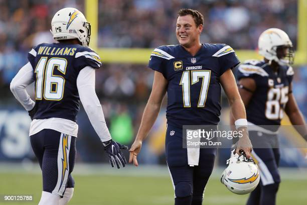 Tyrell Williams of the Los Angeles Chargers and Philip Rivers of the Los Angeles Chargers shake hands during the first half of the game against the...