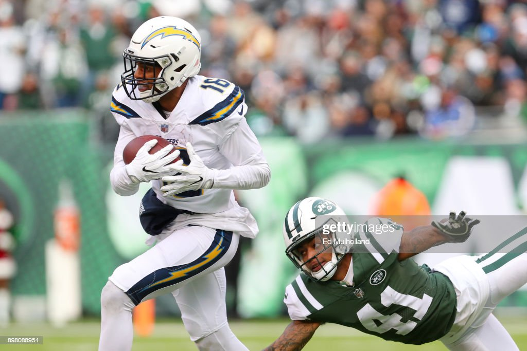 Tyrell Williams #16 of the Los Angeles Chargers carries the ball past Buster Skrine #41 of the New York Jets during the first half in an NFL game at MetLife Stadium on December 24, 2017 in East Rutherford, New Jersey.