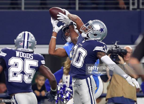 Tyrell Williams of the Los Angeles Chargers catches a pass as Anthony Brown of the Dallas Cowboys and Xavier Woods of the Dallas Cowboys try to...
