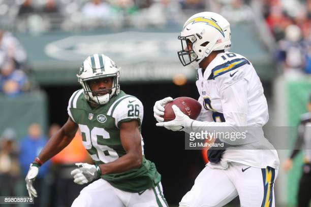 Tyrell Williams of the Los Angeles Chargers is pursued by Marcus Maye of the New York Jets during the first half of an NFL game at MetLife Stadium on...