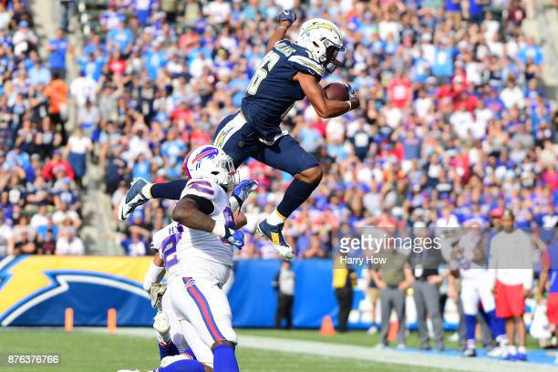Tyrell Williams of the Los Angeles Chargers leaps over Micah Hyde of the Buffalo Bills during the game at the StubHub Center on November 19 2017 in...