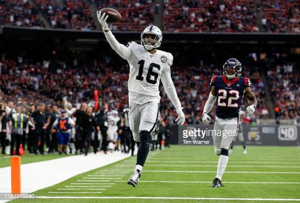 Tyrell Williams of the Oakland Raiders catches a pass and runs for a touchdown in the second half against the Houston Texans at NRG Stadium on...
