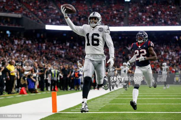 Tyrell Williams of the Oakland Raiders catches a pass for a touchdown defended by Gareon Conley of the Houston Texans in the third quarter at NRG...