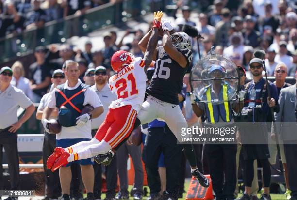 Tyrell Williams of the Oakland Raiders catches a pass over Bashaud Breeland of the Kansas City Chiefs during the first quarter of an NFL football...