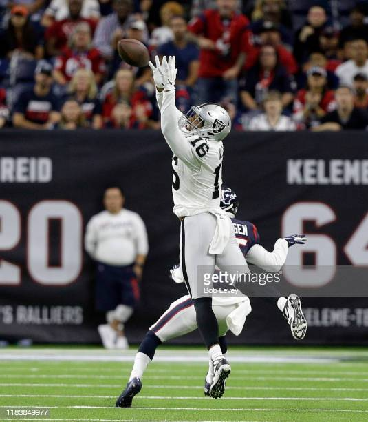Tyrell Williams of the Oakland Raiders has a pass go through his hands as Keion Crossen of the Houston Texans defends during the fourth quarter at...