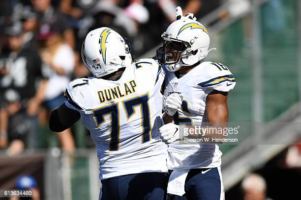 Tyrell Williams of the San Diego Chargers celebrates with King Dunlap after scoring a touchdown against the Oakland Raiders during their NFL game at...