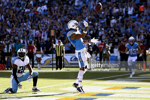 Tyrell Williams of the San Diego Chargers scores a touchdown in the first half as Perrish Cox of the Tennessee Titans looks on at Qualcomm Stadium on...