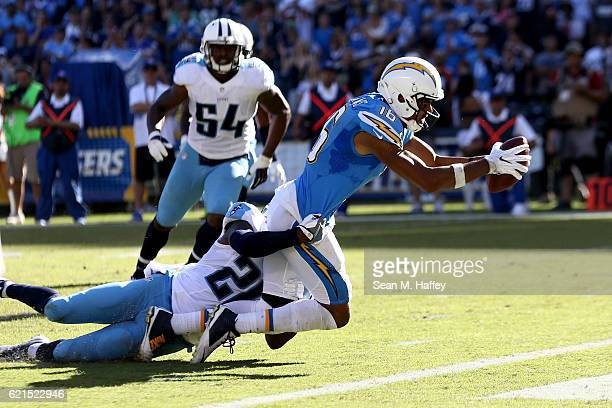 Tyrell Williams of the San Diego Chargers scores a touchdown in the first half as Perrish Cox of the Tennessee Titans defends at Qualcomm Stadium on...